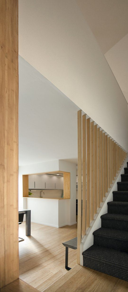 blond wood . white . black/ebony ~ stairwell 'wall' and wood finish on inner planes for kitchen pass-through http://appsforbuilders.com/