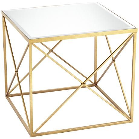 Celebrate the elegant combination of gold and mirror with this square side table.