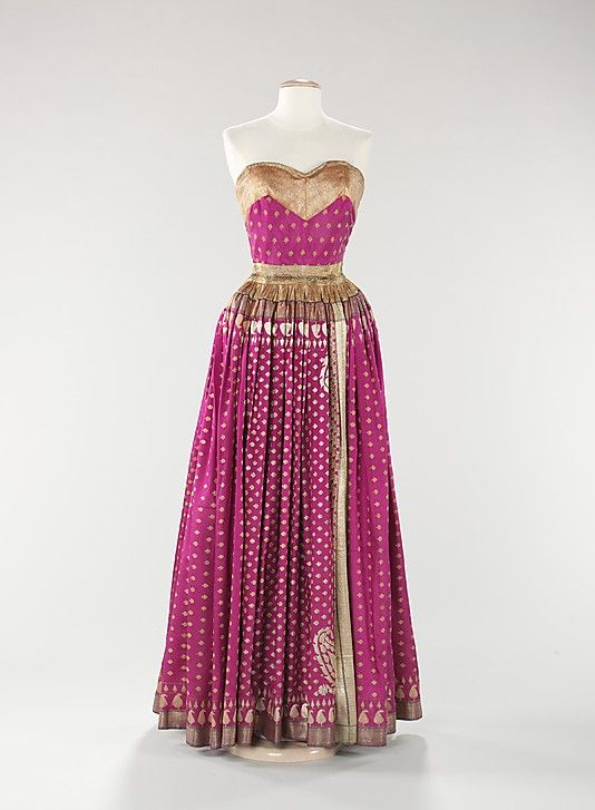 Evening dress, Mainbocher, 1950. Mainbocher was particularly well known for the diversity of designs he created using Indian sari silks. This evening dress is an exquisite example of one of his creations, which he likely discussed with its wearer, Millicent Rogers.