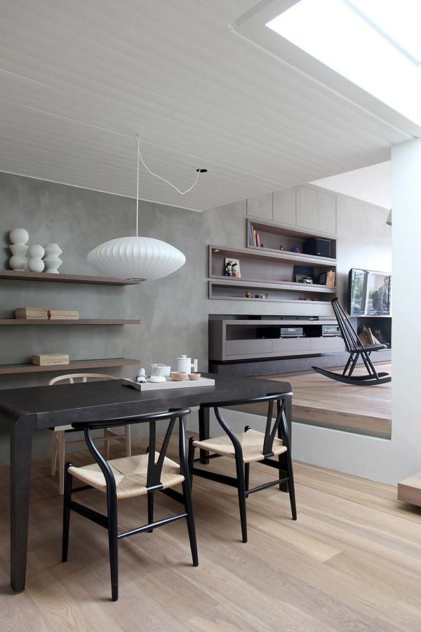 Dining Room | wooden floors + soft gray plaster wall + black and white accent in furniture