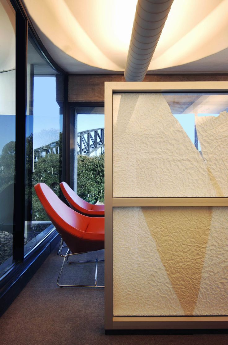 A small meeting room with harbour views at the end of the paper wall corridor run. Brooke Aitken Design.