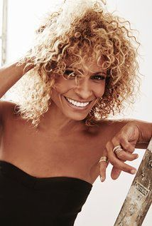 I think Michelle Hurd is beautiful. I wish my curls looked that good.