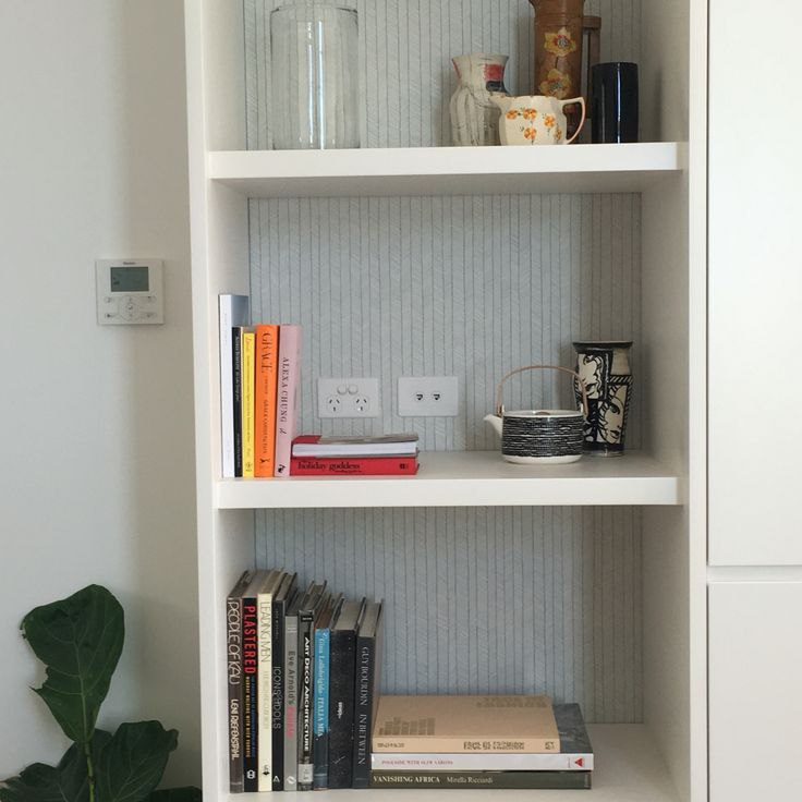 Wall paper to the back of the open shelf unit is a unique idea.