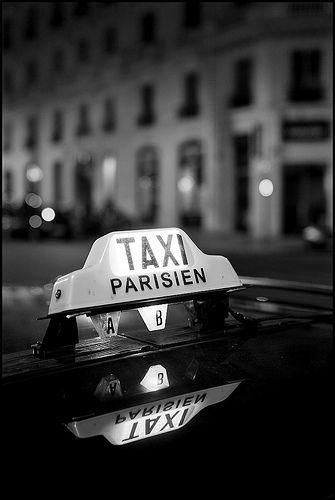 Taxi in Paris by Damien Derouene.