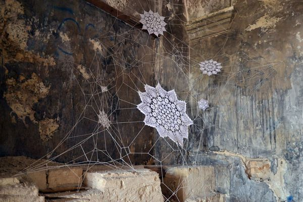 Polish artist NeSpoon combines lace-making, ceramics and street art. The result…