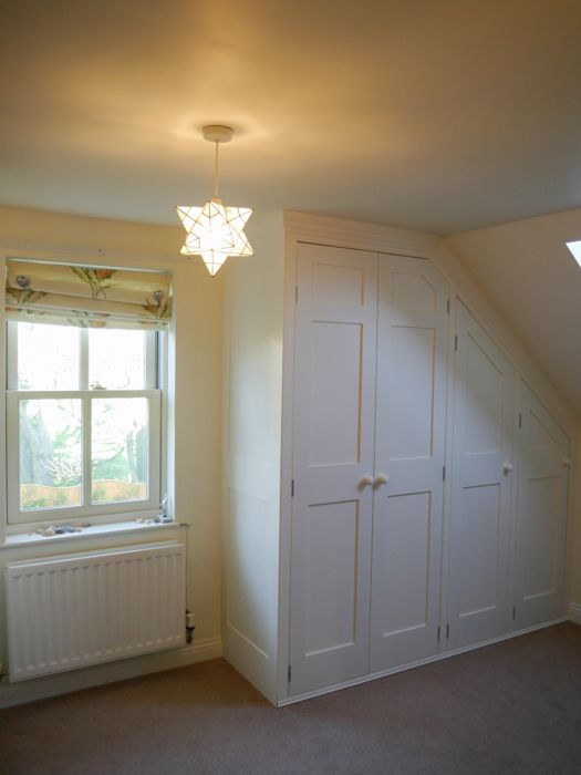 Straightforward attic wardrobes (unless you are Mr D making them with your set square and knowledge of trigonometry!) Wonderful starry light too!