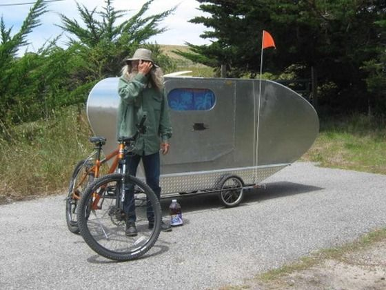 Jeff's Air Stream Bike Camper is one of the more better designed of the home made bicycle campers out there.