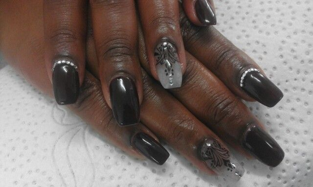 Vixen gel, one nail translucent gray gel with a black tribal stamp and silver diamontes