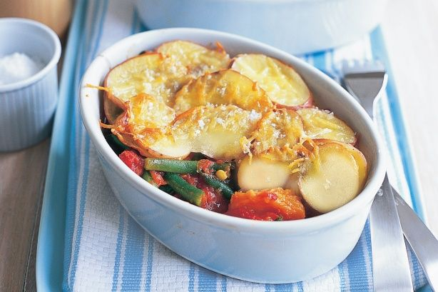 Use a hearty vegetable and chickpea stew as the base for these golden pies topped with potatoes and parmesan.