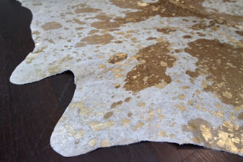 Gray and gold hide...perfect for my foyer...love love love!  Obsessing.