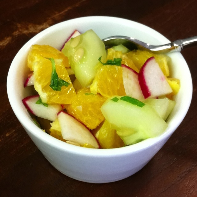 Simple yummy spring salad: sliced cucumbers and radishes, orange ...