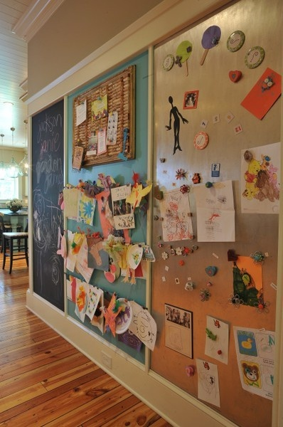 Nice idea - chalkboard, art hanging area, magnet board all on one wall. (Link was bad)