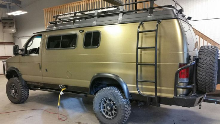 Sportsmobile with Aluminess bumpers, ladder and roof rack.  Wrap by Rockit West and build by KC Truck Performance Center