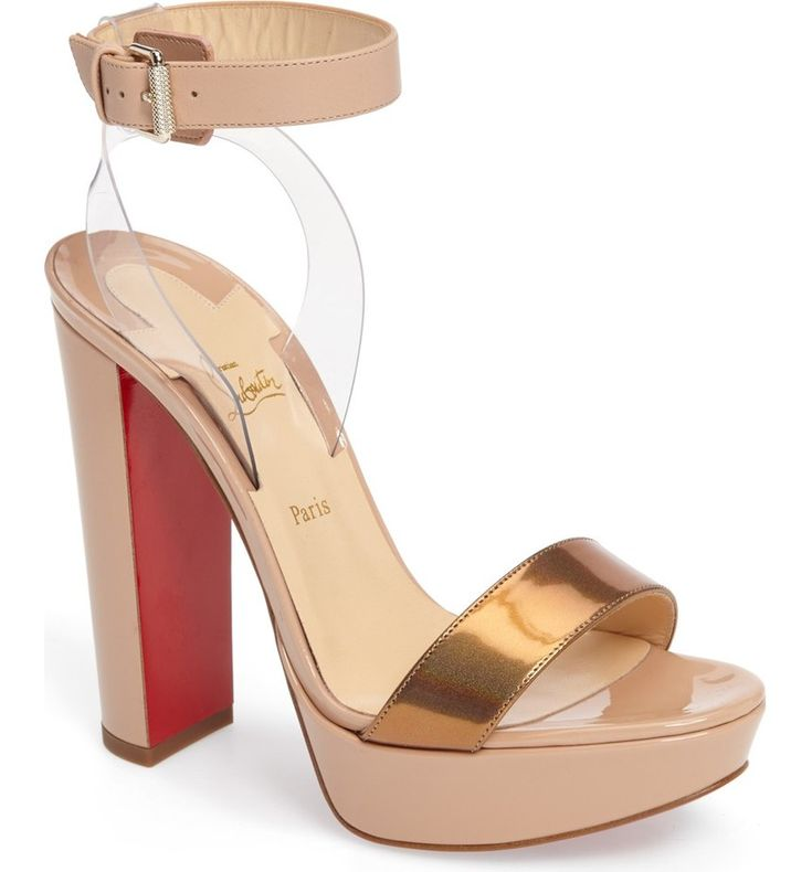 A belted ankle strap appears to float above a gorgeous platform sandal lifted by a covered half-moon heel. Christian Louboutin's iconic red sole—born from a fateful brush with red nail lacquer—adds a signature pop of color with every step you take.