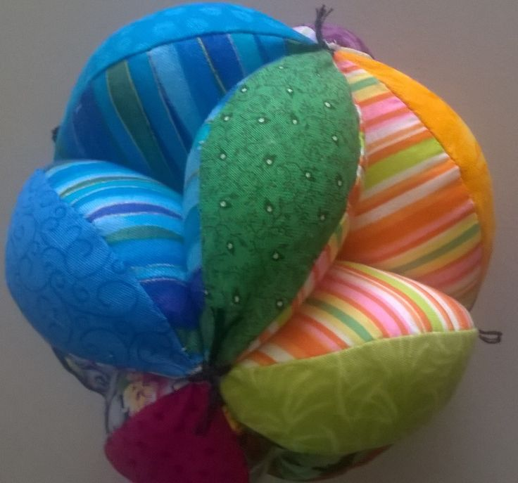 I made this Amish puzzle ball for a friend's new baby.  I love all the bright colours. A fun project.