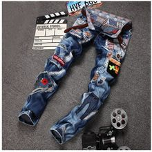 Pantalones vaqueros rasgados y rayados con agujero de algodón para hombres
