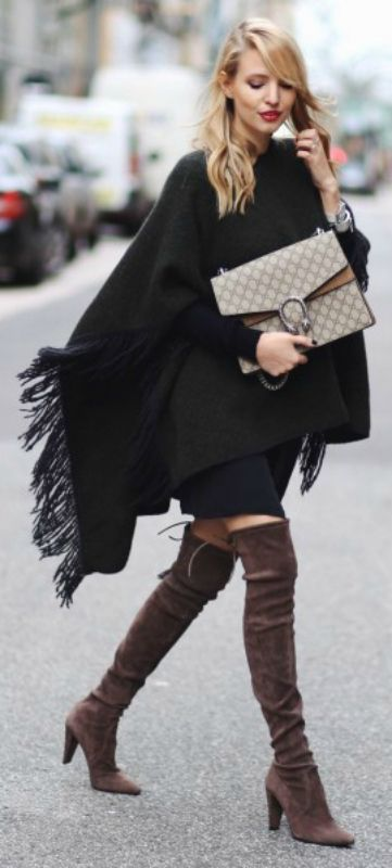The poncho trend is another which goes brilliantly with over the knee boots. Leonie Sophie wears a fringed green poncho with patent brown boots and a gorgeous Gucci bag. Via Just The Design. Poncho: Closed, Boots: Stuart Weitzmann, Dress: Ikks, Sweater: All Saints, Bag: Gucci.