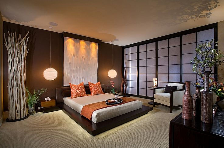 Stunning Asian style bedroom with platform bed and pendant lights 66 Asian Inspired Bedrooms That Infuse Style And Serenity