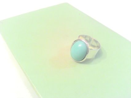 Item#: SP-RING05  In Stock Colour: Silver/Turquoise Measurements: Adjustable 13 x 18 mm Material: Silver-Plated Brass/Czech Glass This beautiful silver-plated brass ring can be adjusted to fit several finger sizes! The opaque turquoise cabochon attached to the top of the ring creates a gorgeous  and versatile piece reflecting your own personal style.