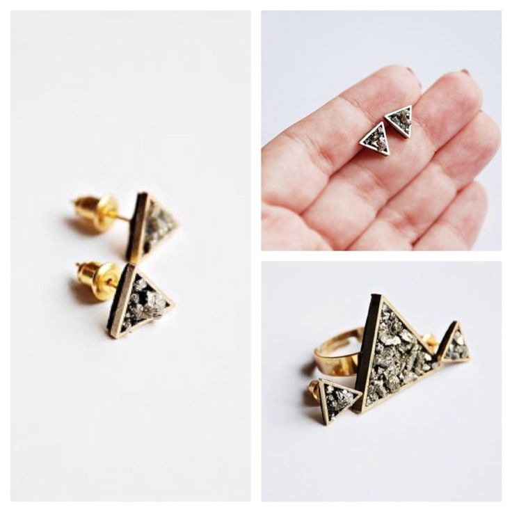 A dainty pair of earrings, featuring a golden triangle with Pyrite stones