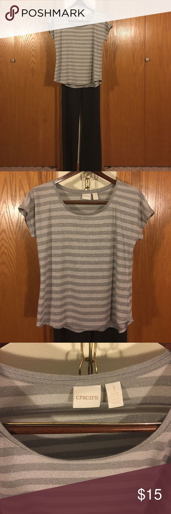 "Chico's Silver Tee that Shimmers! Striped silver and great Tee that has metallic thread woven in fabric.  Chest 18 1/2"" length from shoulder to bottom is 21 1/2"" in front back length measures 23"". Fabric content is cotton, modal, nylon and metallic. Chico's Tops Tees - Short Sleeve"