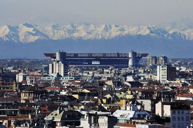 San Siro arena and the mountains shining behind