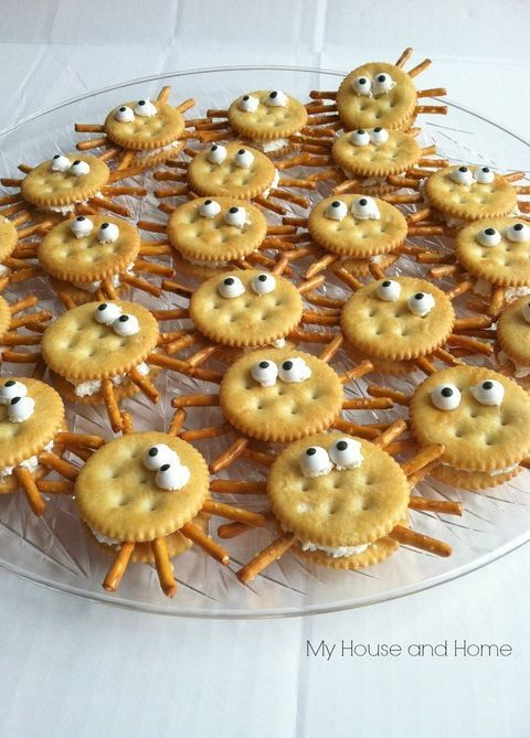 10 fun school snacks. Ritz crackers, peanut butter, candy eyes and pretzels. Easy and yummy! You can also fill them with cream cheese if there are peanut allergies.