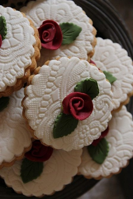 Christmas Cookies made elegant by pressing a paper doily into the icing before completely set