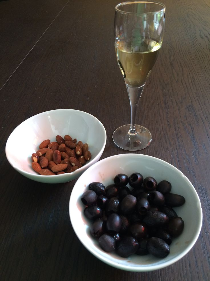 A typical Spanish (Andalusian) aperitivo - a fino sherry, roasted almonds and olives.
