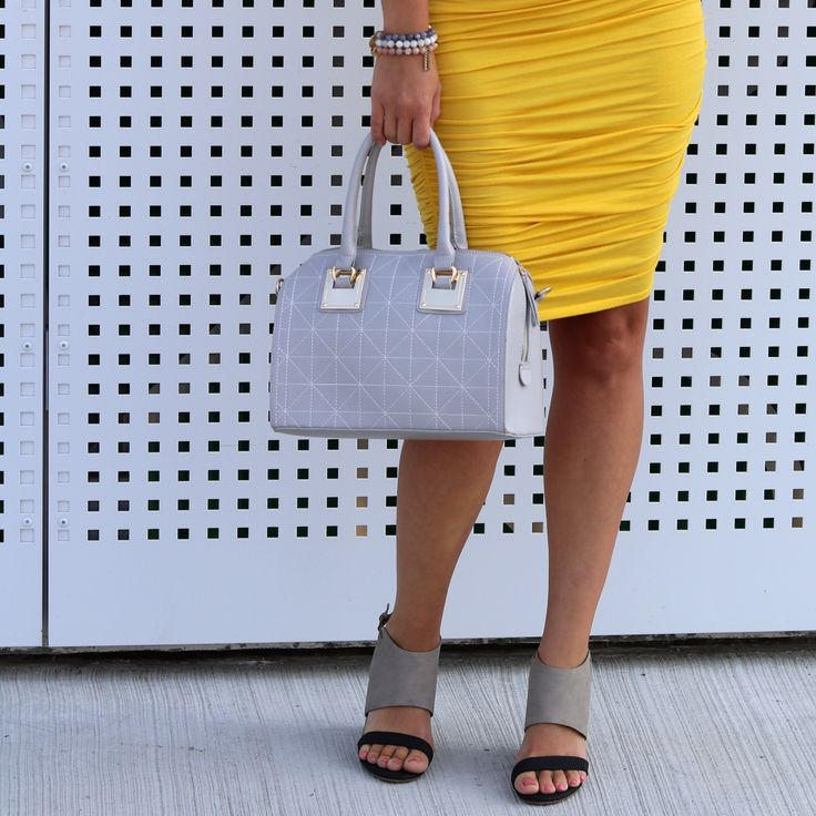 How gorgeous is this yellow racer back dress paired with the grey tote!