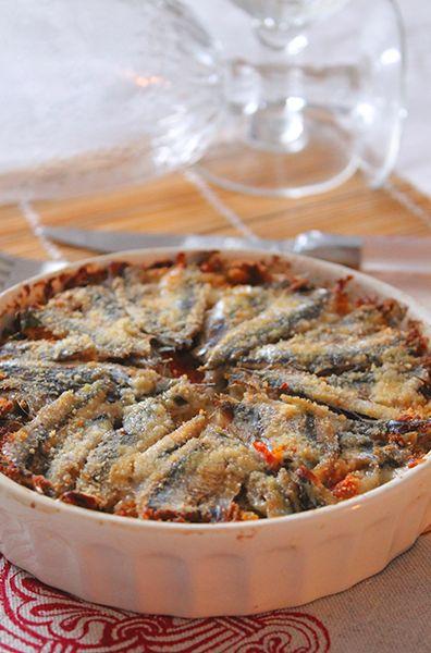 Un delizioso tortino di alici con pomodoro, formaggio e pangrattato.Per tante altre ricette e per vedere il procedimento fotografato passo passo vi aspetto su www.theinsaladwriter.com