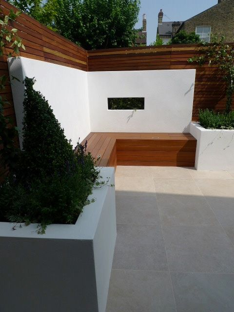 built in bench rendered walls and small london garden design dulwich