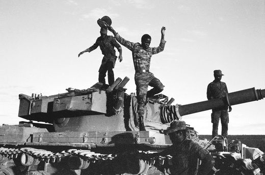 MPLA soldiers with captured South African tank, Cuito Cuanavale, 1988.