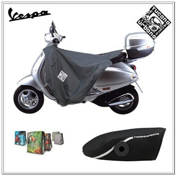Vespa scooter leg cover and Tucano Urbano termoscud. Available with worldwide shipping.Tucano Urbano leg cover for the Piaggio Vespa GTS Super model: * S.G.A.S. anti-flap inflatable system * Large waterproof pocket * Built-in saddle cover * Reflective safety band * Waterproof outer shell made of heavy Nylon...