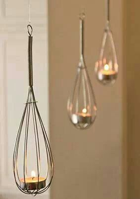 Hang the whisks from ceiling with cooking twine and put a tea light candle in each.