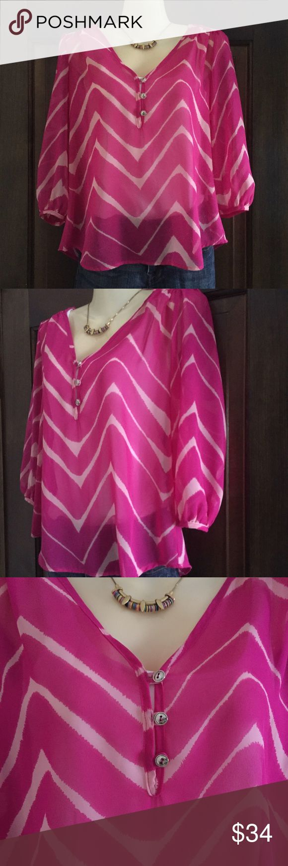 "Wavy Chevron Print 3/4 Sleeve Blouse Fabulous, flirty, flowy, flattering, and forgiving, perfectly describe this pretty top.  Work or play, night or day, this will be a great addition to your summer wardrobe.  Pretty wavy hot pink and light pink chevron pattern.  Sheer, lightweight fabric with 3 silver button accentuating the v-neckline, rounded neckline, and 3/4 sleeves. Stitch Fix purchase, washed, but not worn.  Approx. measurements: 19"" bust from underarm, 17"" sleeve, 21"" length.  100%…"