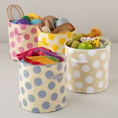 Dotted Floor Bin  | LandOfNod -- Super cute for a girl (pink polka dot!) but seems a little too girly for a boys' toy storage