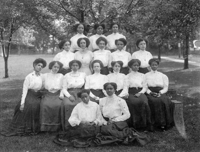 The 1909 sewing class of the Combined Normal Institute, Wilberforce University in Wilberforce, Ohio. Left to right. Top row: Alma Wyatt, Eva Winfree, Mattie Curtis. Second row from top: Carolyn Whitman, Ada Roundtree, Virginia Robinson, Fanny Butler, Julia Worsham. Third row from top: Mrs. M. Maxwell, Stella Bradford, Ethel Wilborn, unidentified, Effie Hurd, Margaret Jones, Jeanette Johnson. Bottom row: unidentified, Opra Warren.  Photo courtesy of Brown Girl Collective on Facebook.