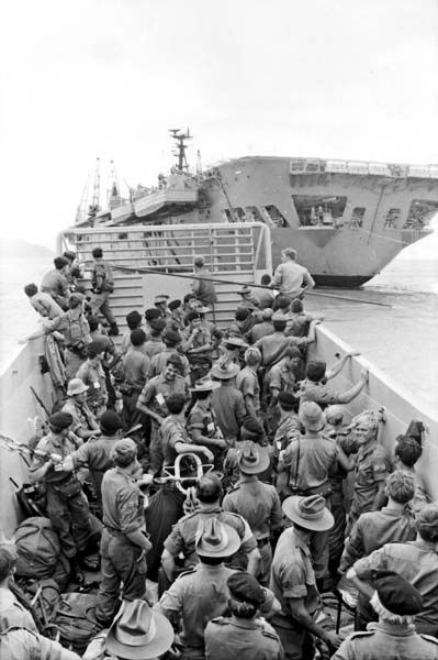 Vietnam War, Australian troops embarking on HMAS Sydney ..former aircraft carrier, converted to troop  and equipment transport