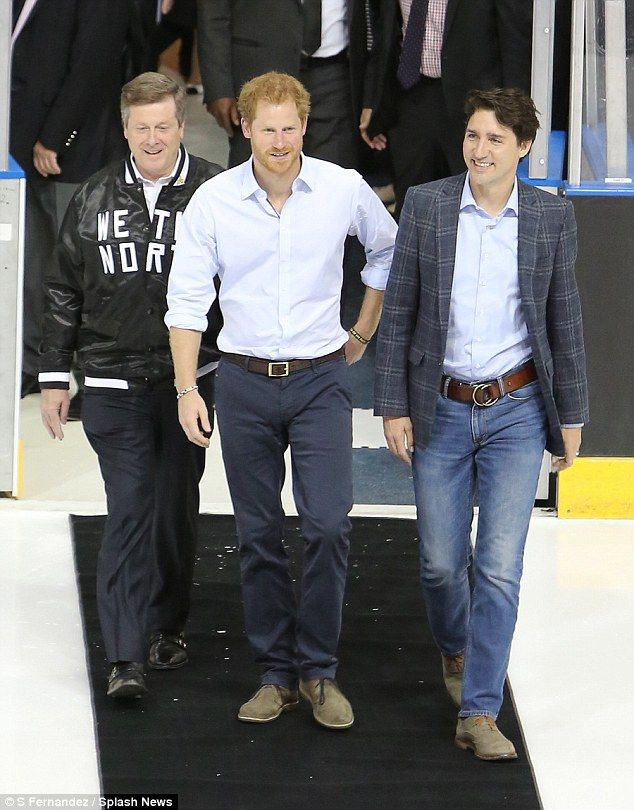 Harry walked out into the stadium flanked by Justin and the Toronto mayor