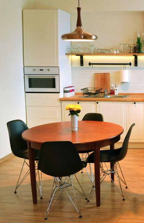 Kitchen in scandinavian style. Teak table, dsr black chairs, white brick tiles, open shelves, cream/ecru walls. Maszroom.com