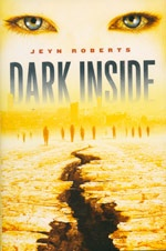 Dark Inside - Jeyn Roberts  Mason's mother is dying after a terrible car accident. As he endures a last vigil at her hospital bed, his school is bombed and razed to the ground, and everyone he knows is killed. Aries survives an earthquake aftershock on a bus, and thinks the worst is over when a mysterious stranger pulls her out of the wreckage, but she's about to discover a world changed forever. -OLA
