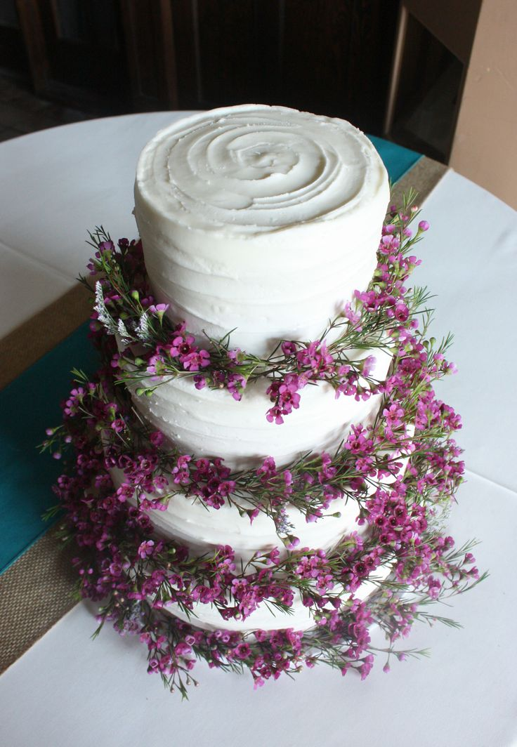 Purple Wax Flowers on Rustic Wedding Cake. Here is a pic of the cake that I described.