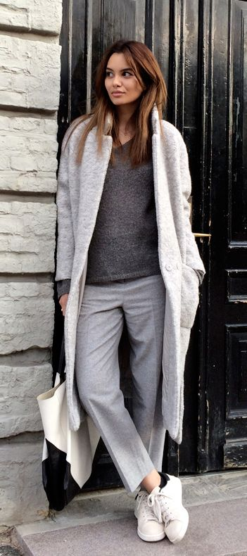 Funda Christophersen is wearing a grey long coat from Ganni, jumper from Moliin, trousers from Cos, bag from Celine and the shoes are from Adidas:
