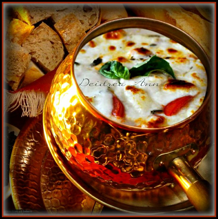CAPRESE FONDUE  * 16 ounces fresh mozzarella cut into cubes  * 1/2 pkg. cream cheese  * 5 teaspoons cornstarch  * 1 package grape or cherry tomatoes cut in half  * 2 cups dry white wine   * Freshly ground white pepper  * 1/4 cup chopped red onion and   * 1/2 cup  chopped fresh basil   * 1/2 tsp. crushed red pepper  *  2 T. Zesty Italian Dressing  * Drizzle of  the best Balsamic Vinegar   * Bite-size pieces of focaccia,tortilla chips, french bread, for dipping