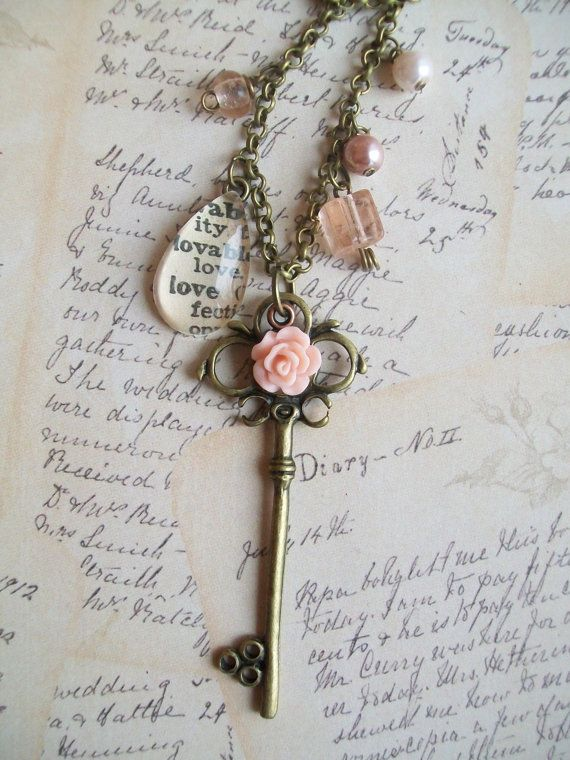 Antique brass old fashioned key with peach/pink by NoTwoTheSame, $15.00