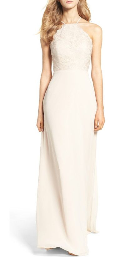 lace halter gown by Hayley Paige Occasions. Romantic lace overlays the fitted bodice of a halter-inspired gown that floats easily to a graceful, floor-sweeping h...