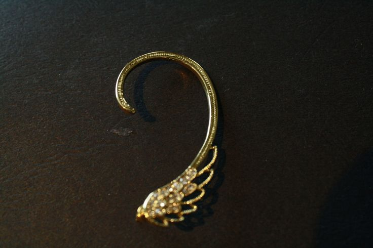 Wrapping Angel Wing Ear Cuff #bright #earcuff #earring #gold #jewelry #jewels #piercing #pretty #steampunk #wings  40% off orders over $50.  Free shipping and handling orders of $25 or more.  #Christmas #Present  www.ceesquared.ca