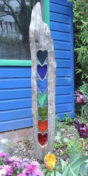 Stained glass hearts in driftwood