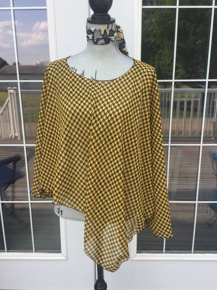 Super cute houndstooth chiffon print in this Lucylu wrap!!!  My original design on the poncho!  Side slits for each arm makes it easy to wear under a jacket. All you wear underneath is a tank top or cami !  Great as a swimsuit coverup too.  One size fits real women